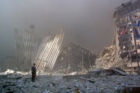 "(FILES) This file photo taken on September 11, 2001 shows a man standing in the rubble, and calling out asking if anyone needs help, after the collapse of the first World Trade Center Tower in New York City. Al-Qaeda mastermind Osama bin Laden was killed late on May 1, 2011 in a firefight with covert US forces deep inside Pakistan, prompting President Barack Obama to declare ""justice has been done"" a decade after the September 11 attacks. AFP PHOTO / FILES / Doug KANTER (Photo credit should read DOUG KANTER/AFP/Getty Images)"