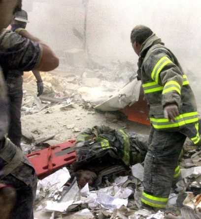 UNITED STATES - SEPTEMBER 11: The World Trade Center was destroyed by two planes containing hijackers. Firefighter Kevin Shea of Ladder 35 lies semi conscious in debris field with Firefighter Ritchie Nogan of 113 standing over him. Shea was the only survivor of his unit. He was carried out by Nogan, two EMS workers and photographer Todd Maisel. (Photo by Todd Maisel/NY Daily News Archive via Getty Images)