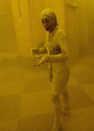 "New York, UNITED STATES: TO GO WITH AFP STORY ""Americans mark 9/11 anniversary with new questions on vulnerability"" - This 11 September 2001 file photo shows Marcy Borders covered in dust as she takes refuge in an office building after one of the World Trade Center towers collapsed in New York. Borders was caught outside on the street as the cloud of smoke and dust enveloped the area. The woman was caught outside on the street as the cloud of smoke and dust enveloped the area. AFP PHOTO/Stan HONDA (Photo credit should read STAN HONDA/AFP/Getty Images)"