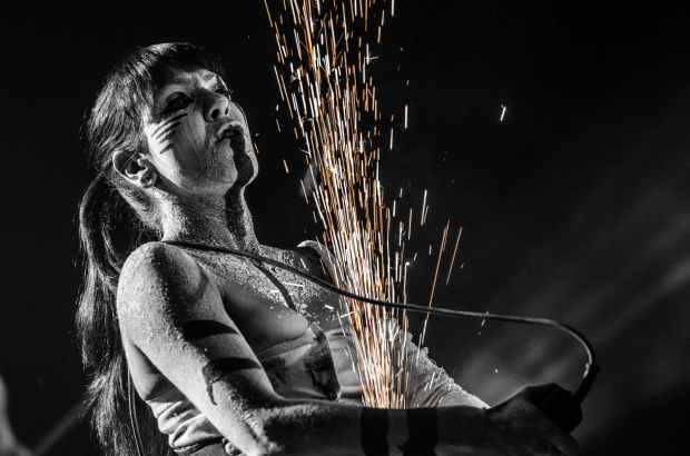 grayscale photography of woman with spraklers