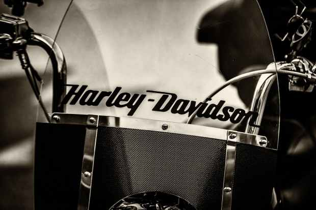 graysacle photography of black harley davidson motorcycle