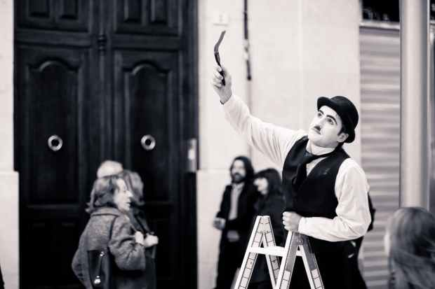black and white streets street art mummer