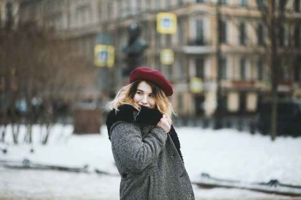 woman wearing coat and red hat during snowy day