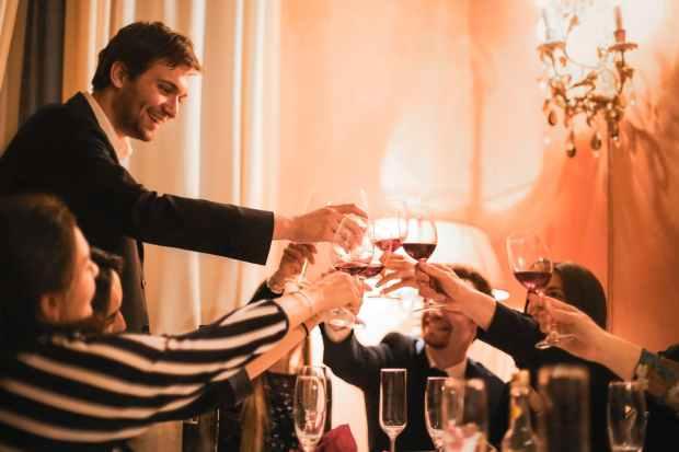 people toasting beverage glasses