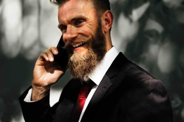 beard blur cellphone close up