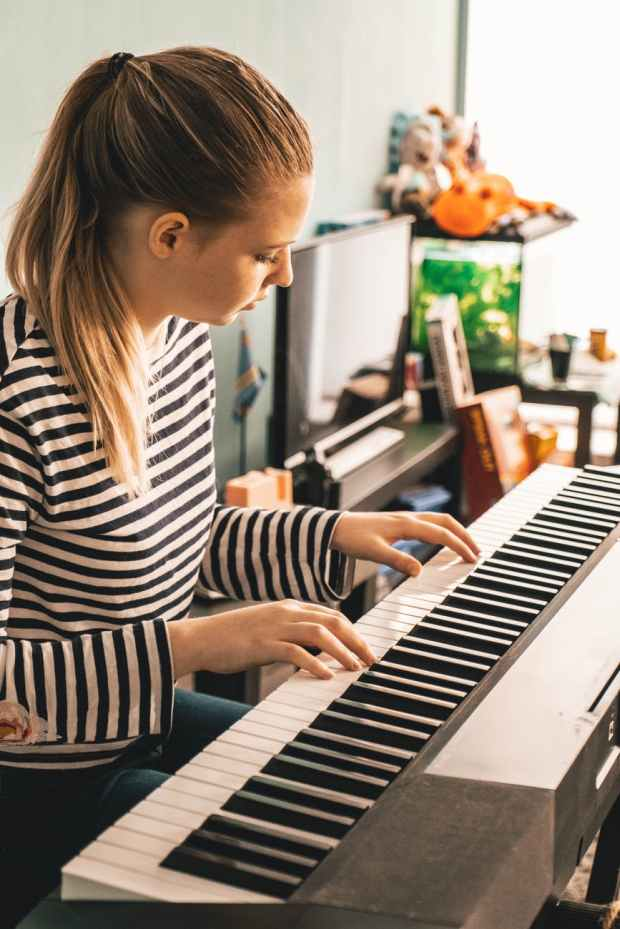 photo of woman playing piano